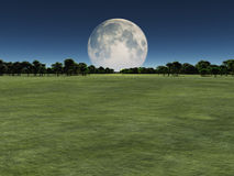 Moon over green landscape Royalty Free Stock Photography