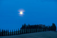 Moon over the hills of Tuscany, Italy Stock Images