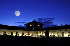 Moon over hotel building Royalty Free Stock Images