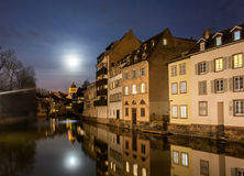 Moon over Ill river in Petite France area of Strasbourg. Moon over Ill river in Petite France area, Strasbourg - Alsace, France Royalty Free Stock Image
