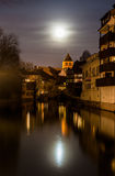 Moon over Ill river in Petite France area of Strasbourg. Moon over Ill river in Petite France area, Strasbourg - Alsace, France Royalty Free Stock Photo