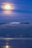Moon Over Jura Mountain, Swiss II. Full moon over snow covered Jura mountain range and Lake Geneva at dawn Stock Photography