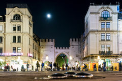 Moon over the Karlstor in Munich Royalty Free Stock Image