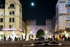 Moon over the Karlstor in Munich Stock Image