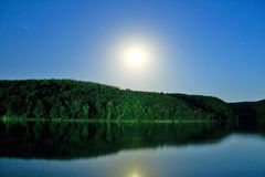 Moon over the lake Stock Images