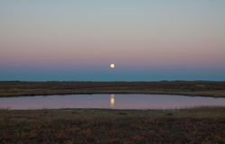 Moon over the lake. Far Russian North. Stock Image