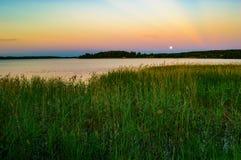 Moon over lake Stock Image