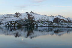 Moon over the lake in the Swiss Alps Royalty Free Stock Photos