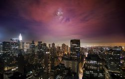 Moon over Manhattan Midtown. Illuminated skyscrapers under the moonlight in Manhattan Stock Image