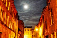 Moon over Metz on a cloudy night royalty free stock photo