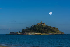Moon over mount st michael island fortress near penzance Stock Images