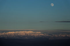 Moon over the mountain peaks Royalty Free Stock Photo