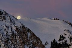 Winter mountain landscape, at night. The Piatra Mare Mountains in the light of the moon, landmark attraction in Romania. Winter mountain landscape, at night. The Royalty Free Stock Image