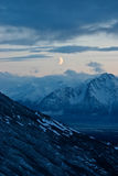 Moon over mountains Stock Photography