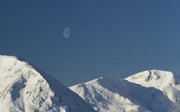 A moon over the mountains Stock Images