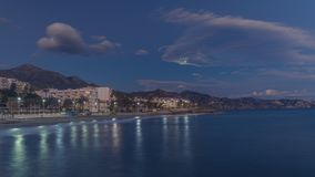 Moon over Nerja town royalty free stock photography