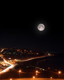 Moon over night roads and embankment Royalty Free Stock Photography