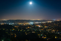 The moon over Northeast Los Angeles at night, seen from Griffith Royalty Free Stock Photography
