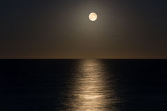 Moon over the ocean. Image of Moon over the ocean Royalty Free Stock Photo