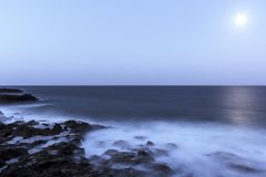 Moon over the ocean - Lanzarote Royalty Free Stock Photography