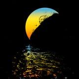 Moon over the ocean Stock Photos