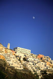Moon over Oia Santorini. The moon is out over Oia Santorini Greece Royalty Free Stock Images