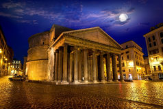 Moon over pantheon in Rome Stock Photos