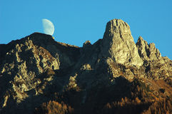 Moon over Pierre Avoi. Moon over the Pierre Avoi famous landmark seen from Verbier and the Rhone Valley Stock Photography