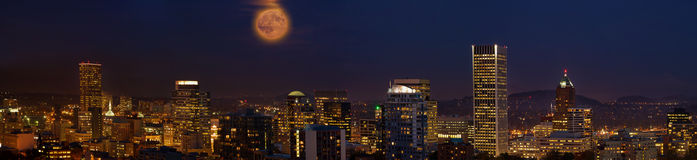 Moon Over Portland Oregon City Skyline at Dusk Royalty Free Stock Images