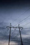 Moon over power lines. Moon rising over the power lines Stock Photos