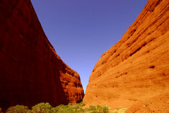 Moon over a red rock canyon. Royalty Free Stock Image