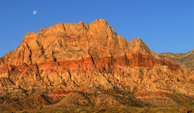 Moon over Red Rock Canyon, Nevada at sunrise Stock Images