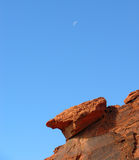 Moon over Red Sandstone near Lake Mead, Nevada. Image shows the moon over the Red Aztec Sandstone in the Redstone Discovery area in the Lake Mead National Royalty Free Stock Images