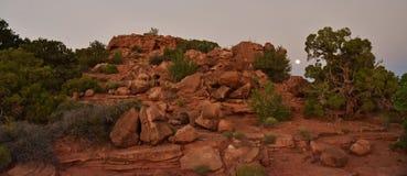 Moon over Rock. Desert moon rising over large pile of rocks in Utah Royalty Free Stock Photos