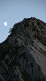 Moon over rock near Tryfan in Snowdonia Stock Images