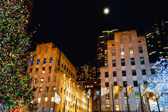 Moon Over Rockefeller Center Royalty Free Stock Images