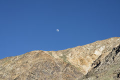 Moon over rocky mountains Royalty Free Stock Photo