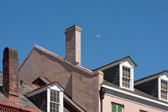 Moon over roof Royalty Free Stock Image