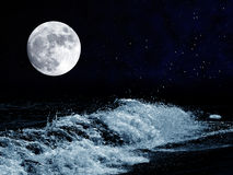 Moon over the sae Stock Photos