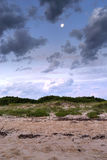 Moon over sand dunes at Bonna Point Stock Image