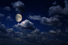 Moon over scattered clouds Royalty Free Stock Images