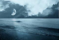 Moon over the sea. Moon over the ocean in the night Stock Photos