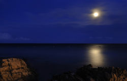 Moon over the sea Royalty Free Stock Images