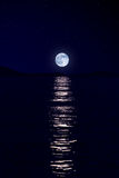 Moon over sea Stock Image