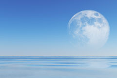 Moon over sea Stock Photography