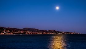 The moon over the sea and Malaga city, Spain royalty free stock photos