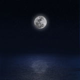 Moon over sea at night Stock Photography