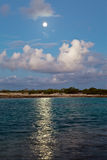 The moon over the sea and reflection in water Royalty Free Stock Photography