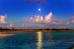 The moon over the sea and reflection in water. Stock Photography