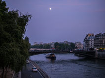 Moon over the Seine on a September evening, Paris, France Royalty Free Stock Image